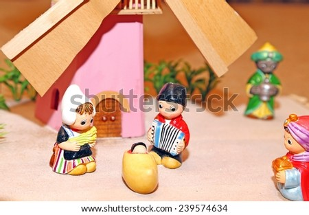 statues of the Nativity scene with Holy Family in Dutch style and a windmill - stock photo