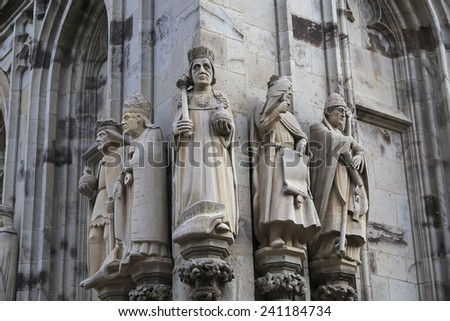 Statues of the saints and kings on cathedral in Cologne, Germany  - stock photo