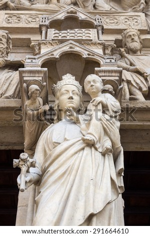 Statues of the saints, angels and kings on the western facade of the catholic cathedral Notre-Dame de Paris. Built in French Gothic architecture, and it is among the largest and most famous church. - stock photo