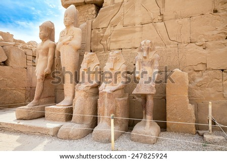 Statues of Thutmose III, unknown Dynasty 13 king, Sobekhotep and Amenhotep II near north side of seventh pylon. Karnak Temple, Luxor, Egypt, Africa - stock photo