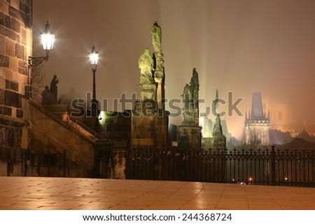 Statues on the Charles bridge illuminated by night, Prague, Czech Republic - stock photo