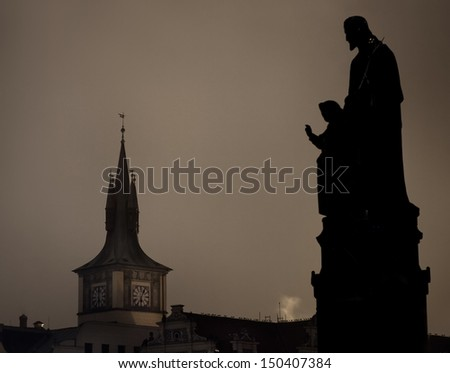 Statues on the Charles bridge, Prague in Czech Republic  - stock photo