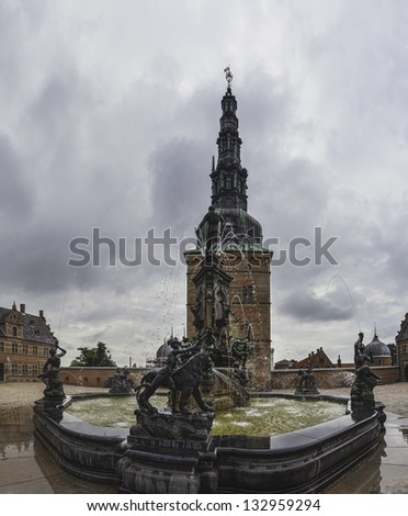 Statues on the fountain at the entrance to Frederiksborg Castle, Hillerod, Denmark - stock photo