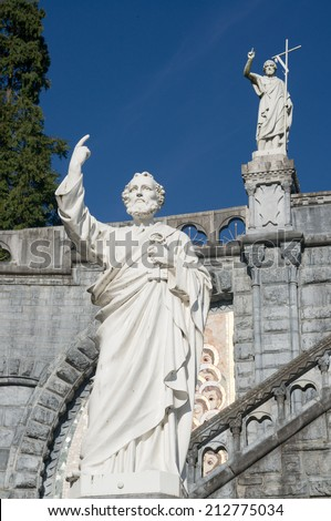 Statues on the square of the cathedral, Lourdes, France - stock photo