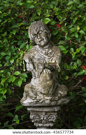 statues with green leaves background in garden