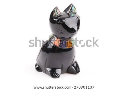 Statuette of a black cat isolated on a white background