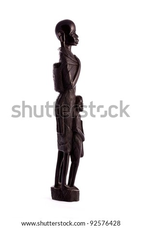 Statuette of a woman and a child the masai tribe curved from ebony - Tanzania - stock photo
