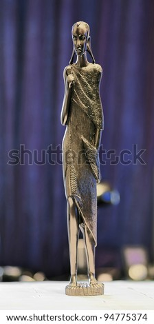 Statuette of a woman the masai tribe curved from ebony - Tanzania - stock photo
