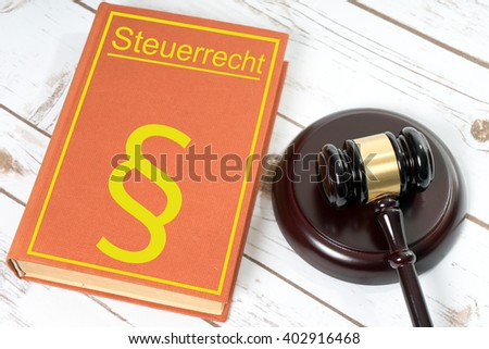 Statute book with the German words tax law and Judges gavel / Statute book - stock photo