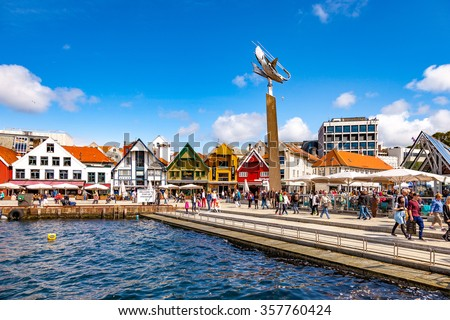 STAVANGER, NORWAY - JULY 15: Lot of tourists walking, shopping and sightseeing city center with many restaurants and pubs around, on July 15, 2015 in Stavanger, Norway. - stock photo