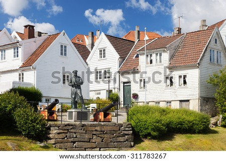 STAVANGER, NORWAY - JULY 23: View to the traditional Norwegian white wooden houses, on July 23, 2015 in Stavanger, Norway. Stavanger is one of most famous travel destinations in Europe.