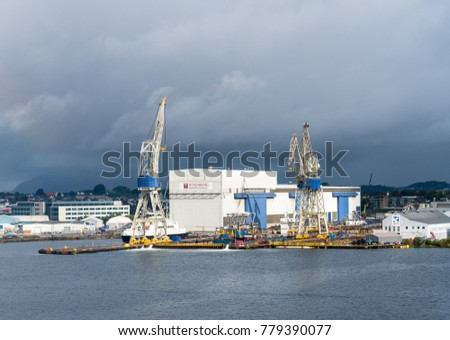 STAVANGER, NORWAY - SEPTEMBER 20, 2017: Oil rig construction company and shipyard Rosenberg in Stavanger Harbor.