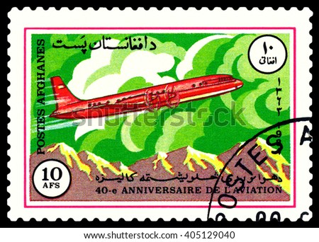 STAVROPOL, RUSSIA - APRIL 05, 2016: A stamp printed  by Afghanistan  shows  old plane IL- 18, series  Sovlet civil aircraft , circa 1984 - stock photo