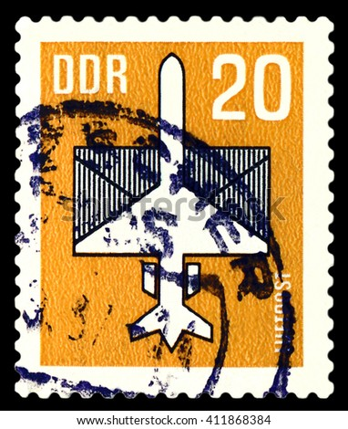 STAVROPOL, RUSSIA - APRIL 05, 2016: a stamp printed by GDR  shows  Plane and Envelope, payment airmail, circa 1957 - stock photo