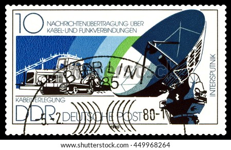 STAVROPOL, RUSSIA - July 08, 2016: a stamp printed by GDR shows  Cable-Laying Vechcle, Dish Antenna , circa 1980 - stock photo