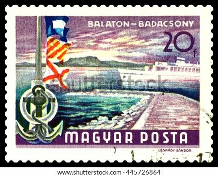 STAVROPOL, RUSSIA - JUNE 28, 2016: a stamp printed by Hungary, shows  Balaton Lake Resorts , flags,  Badacsony hills, circa 1968. - stock photo