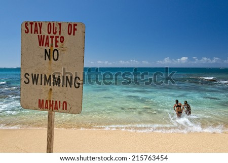 stay away from water danger sign in hawaii on the shore - stock photo