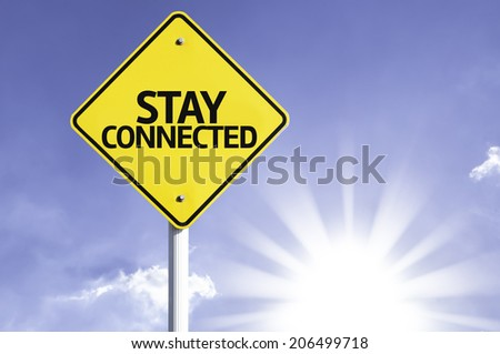 Stay Connected road sign with sun background - stock photo