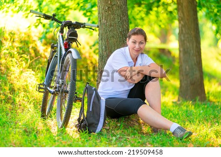 stay in the park next to the bike - stock photo