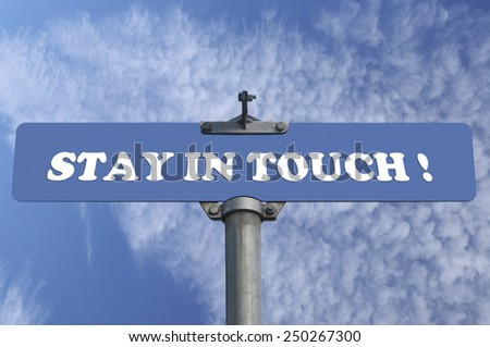 Stay in touch road sign - stock photo