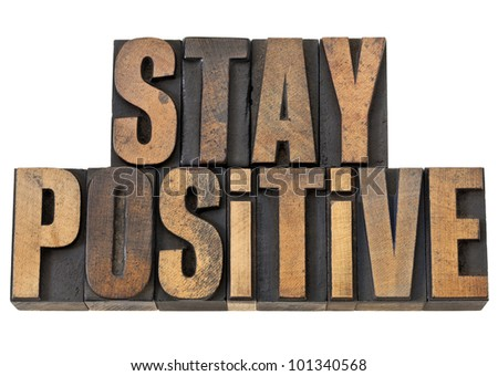 stay positive - motivation concept - isolated text in vintage letterpress wood type - stock photo