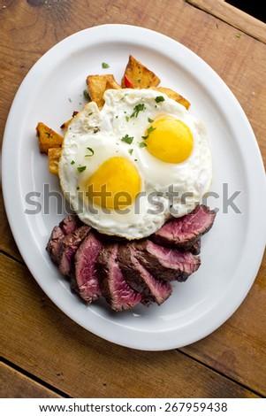 Steak and Eggs  - stock photo