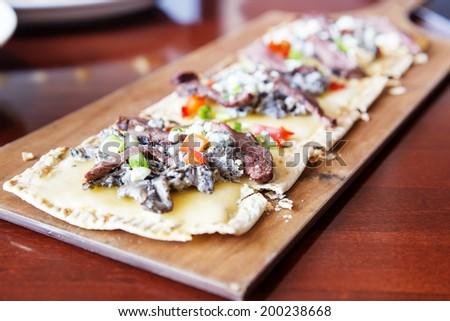 Steak and Wild Mushroom Flatbread - stock photo