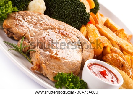 Steak, baked potatoes and vegetables