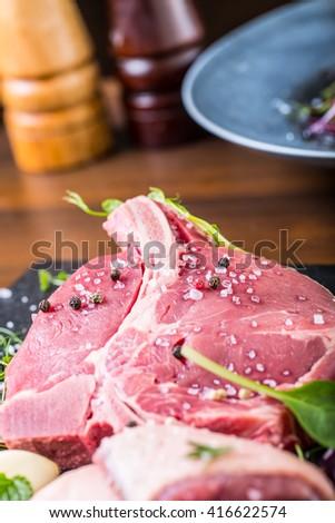 Steak.Beef steak.Meat.Portioned meat.Raw fresh meat.Sirloin steak.T-Bone steak. Flank steak. Duck breast. Vegetable decoration. Portioned meat prepared for processing in a restaurant or hotel kitchen. - stock photo