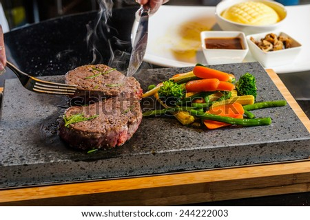 Steak cooked on lava-stone.