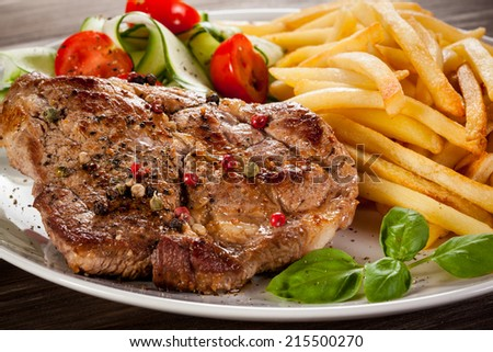Steak, French fries and vegetables