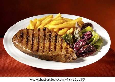 STEAK , FRIES AND SALAD