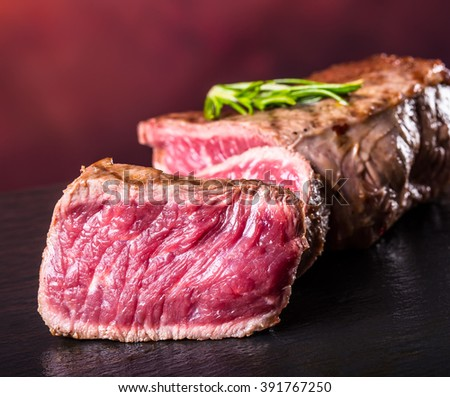 Steak. Grill beef steak. Portions thick beef juicy sirloin steaks on grill teflon pan or granite board. See the full set of 100 amazing photos - stock photo