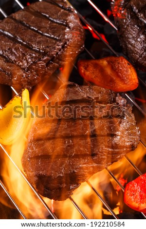 Steak grilling with bbq vegetable on charcoal. Barbecue food party. Closeup roast beef on grill