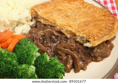 Steak & kidney pie with carrots, broccoli and mash. - stock photo
