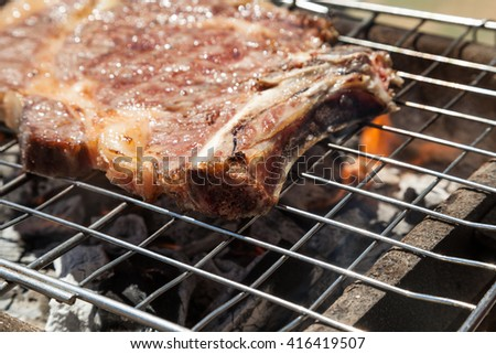 STEAK  ON BARBECUE