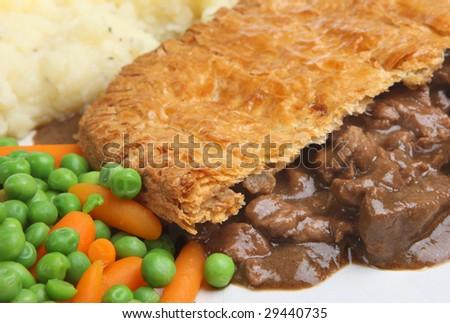 Steak pie with mashed potato carrots & peas - stock photo