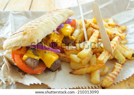 Steak sandwich with fries  - stock photo