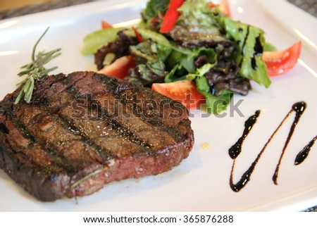 Steak. Steak rib eye. Juicy steak. Done a turn. Meaty hunks. Tasty and delicious grilled meat. - stock photo