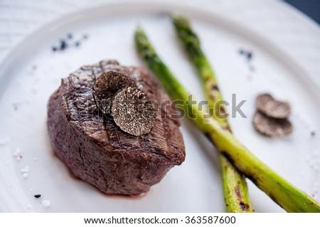 steak with black truffle - stock photo