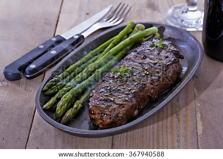 Steak with green asparagus - stock photo