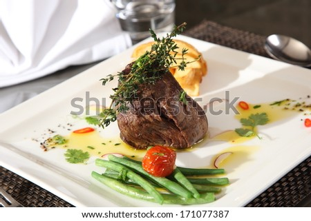 steak with green beans on table