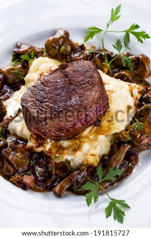 Steak with mushroom sauce and potato gratin