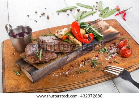 Steak with peas and vegetables - stock photo