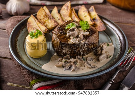 Steak with pepper sauce and mushrooms, roasted american potatoes and homemade mayo
