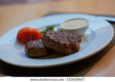 steak with sauce and vegetables