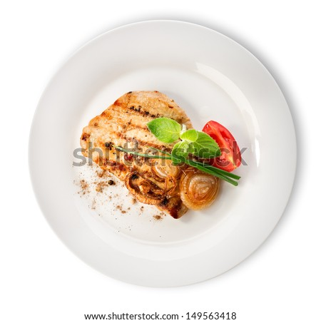 Steak with tomatoes in a white plate isolated - stock photo