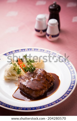 Steak with vegetables and  red sauce - stock photo