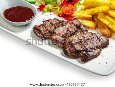 steak with vegetables, fries and barbecue sauce in a bowl on white background