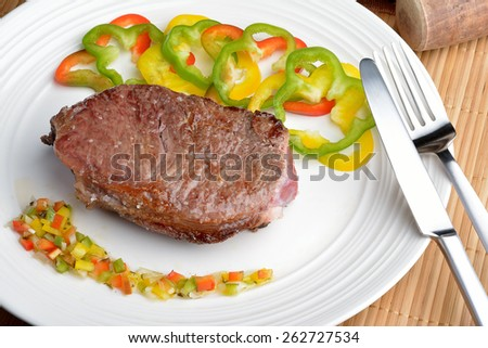 steak with vinaigrette: sweet pepper, onion and tomato